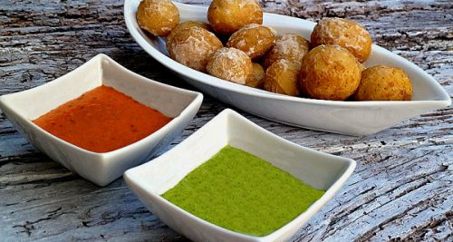 Red and green mojo sauces with papas Arrugadas