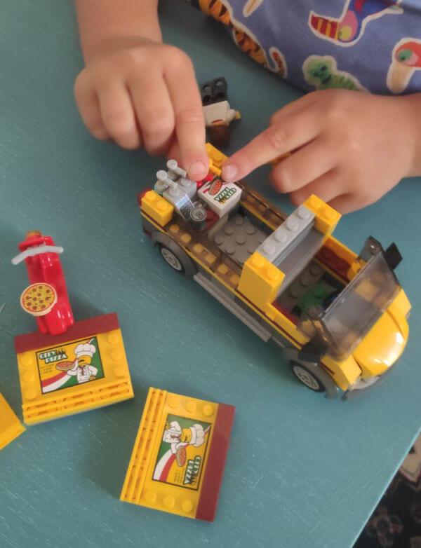 Kids and Bricks boy with lego car