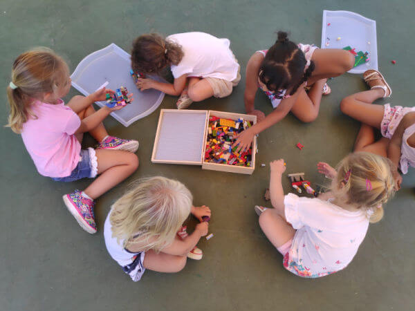 Kids and Bricks girls playing with lego